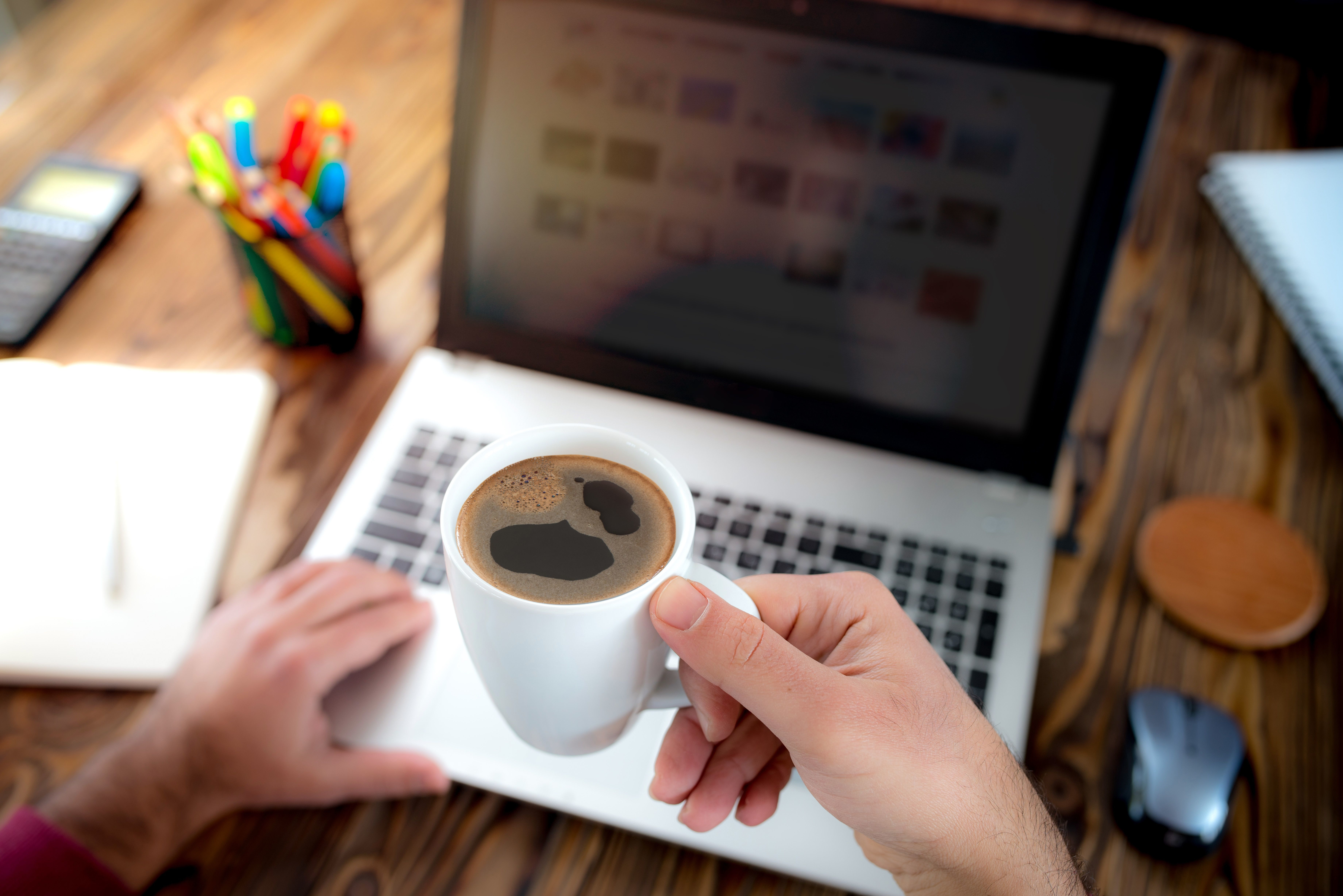 laptop and coffee - tools for improving workplace productivity